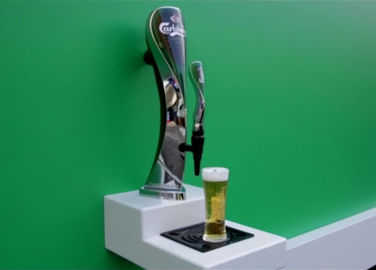 Image: Carlsbery poster dispenses free beer and it's probably the best stunt of the year