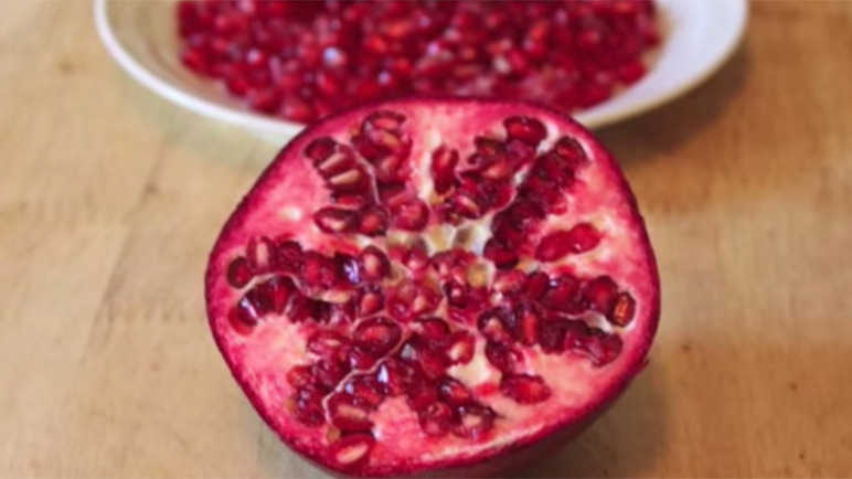 Image: How to de-seed a pomegranate without ruining your t-shirt