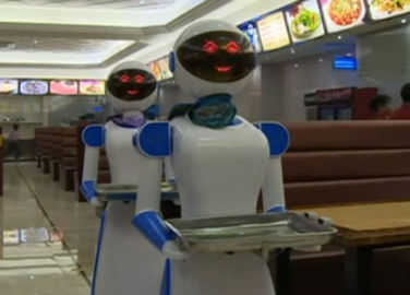 Image: Restaurant in China replaces humans with robot waiters