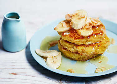Coconut flour pancakes with banana and agave syrup