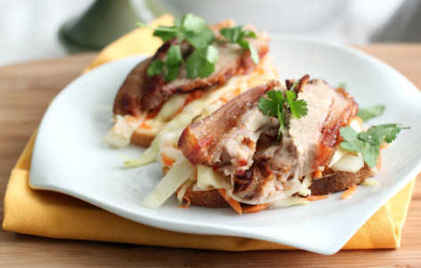Roasted pork belly open sandwich with garlic mayo, roasted pickle and coriander