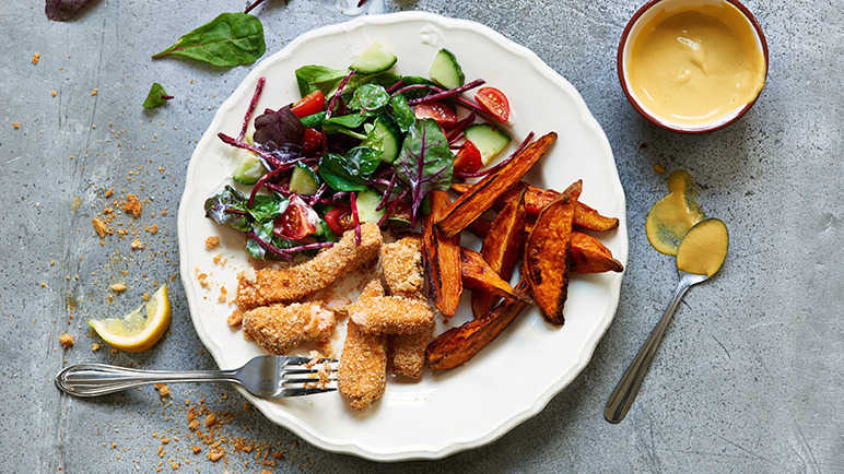 Salmon fish fingers with cherry tomato salad and sweet potato chips