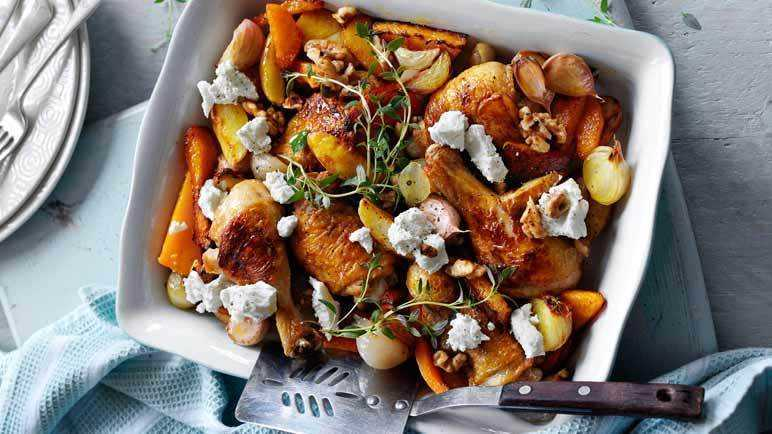 Baked chicken pieces with butternut squash and walnuts