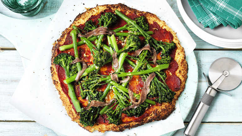 Cauliflower pizza with broccoli and anchovies