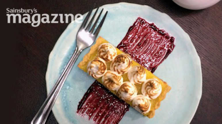 Lemon meringue tart with blackberry coulis