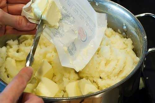 Adding butter to mash