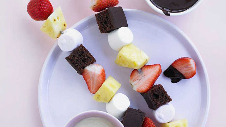 Sweet skewers with chocolate sauce