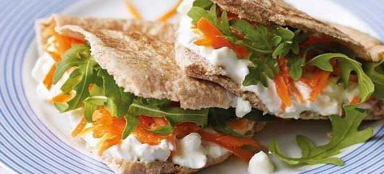 Cottage cheese, grated carrot and rocket pitta