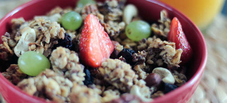 Bowl of granola, grapes and strawberries