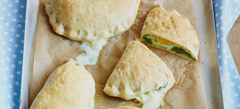 Little spinach and egg calzones