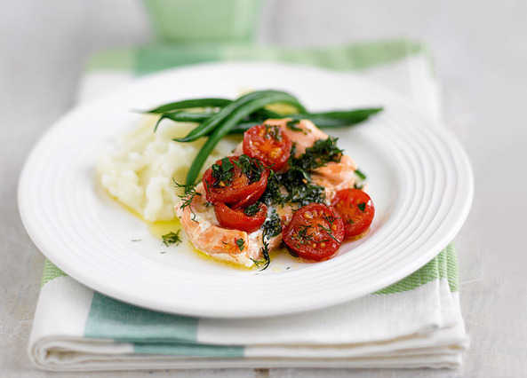 Baked salmon parcels with lemon and herb butter
