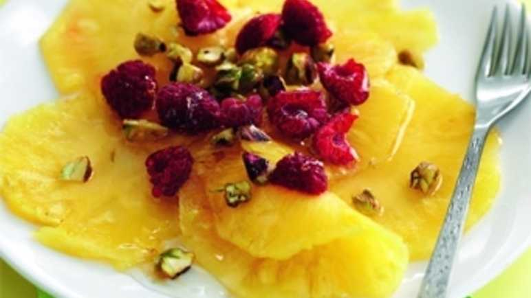 Pineapple carpaccio with raspberries and maple nut image
