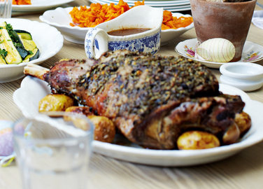 Herb and garlic leg of spring lamb with roasted new potatoes