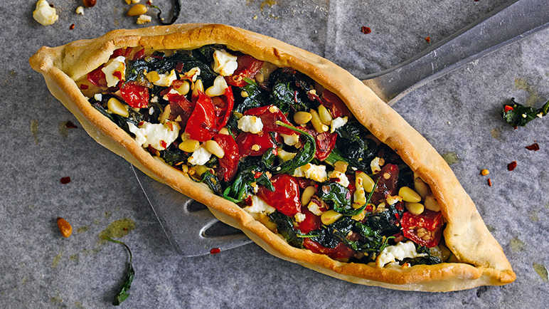 Image: Spiced spinach, feta, pine nut and chilli Turkish pide