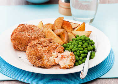 Image: Salmon fishcakes with wedges and peas