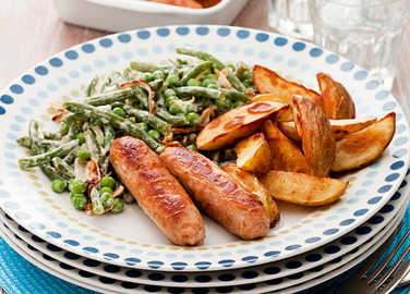 Sausages, potato wedges and creamy greens