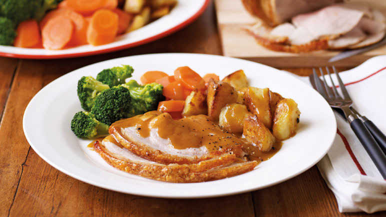 Image: Roast pork, with roast potatoes, carrots & broccoli