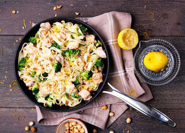 Image: Creamy salmon and broccoli tagliatelle with toasted hazelnuts