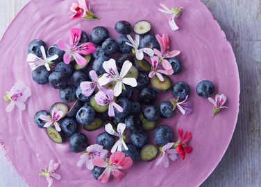 Image: Blueberry lemon mousse cake with scented geranium flowers