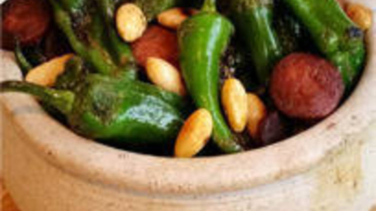 Spanish-style padron peppers with chorizo and almonds