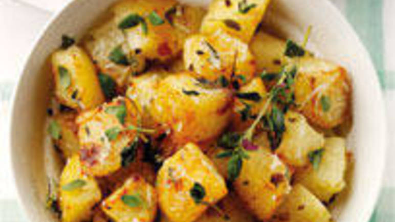 Large image for Thyme and garlic roast potatoes recipe on Sainsbury's Online