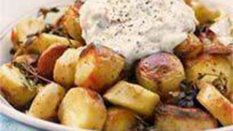 Large image for Sainsbury's Barbecued roast potatoes with sundried tomato and chive dressing recipe