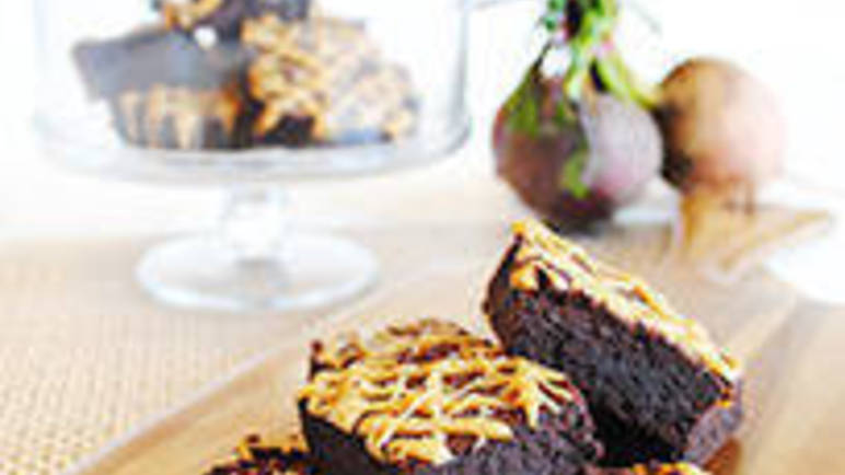 Large image for indulgent chocolate fudge brownies with salted caramel drizzle from Sainsbury's online