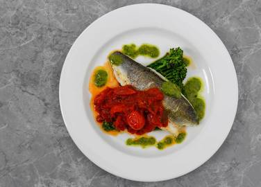 Image: Pan fried seabass with brocolli and puttanesca sauce