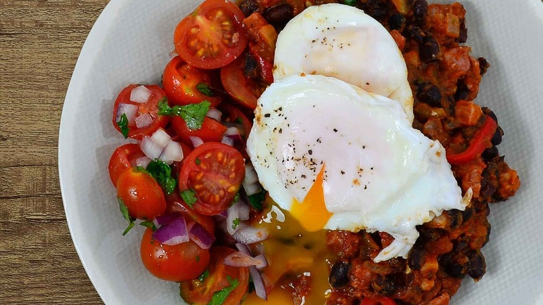 Image: Refried beans with poached eggs, lime and tomato salsa