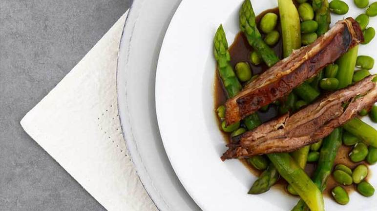 Image: Honey glazed lamb breast with broad beans, asparagus & fresh mint