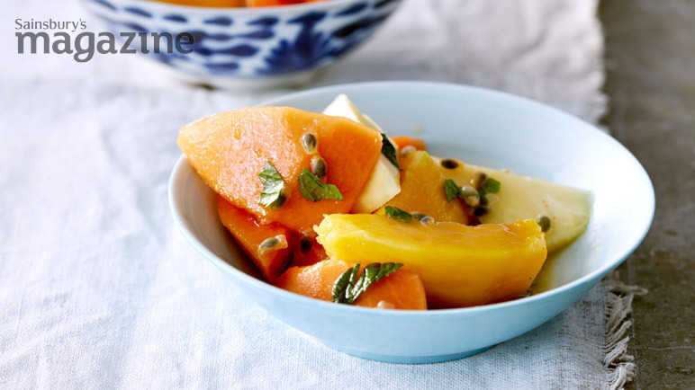 Tropical fruit salad with mint and passion syrup
