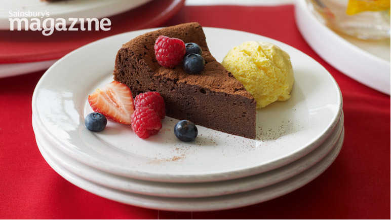 Chocolate brownie cake with berries and ice cream