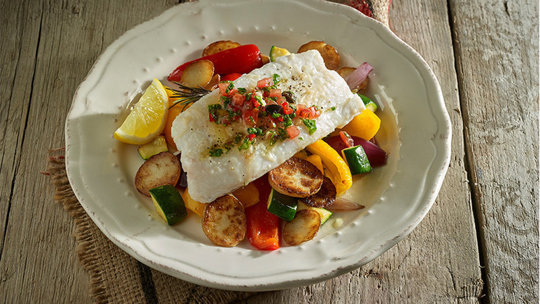 Image: Oven roasted cod and vegetables with spicy salsa