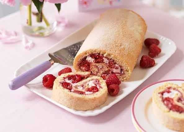 Swiss roll with fresh raspberries image