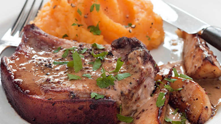 Mustard pork chops with pears & root vegetable mas image