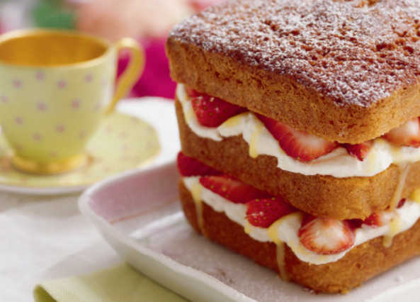 Victoria sandwich loaf with strawberries and crea image