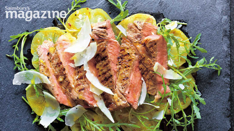 Steak tagliata with yellow tomatoes, oregano and mustard
