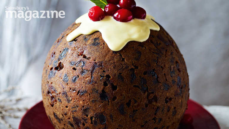 Cranberry gingerbread christmas pudding with ginger sauce
