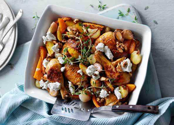 Baked chicken pieces with butternut squash and walnut image