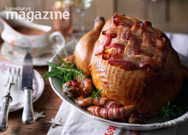 Roast turkey with cranberry stuffing and pigs in blankets