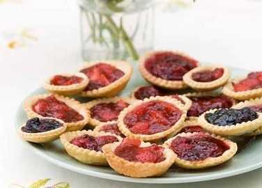 Jam tarts with fresh berries