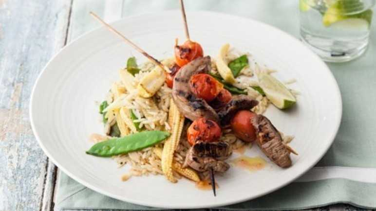 Sweet chilli beef skewers with vegetable ric image