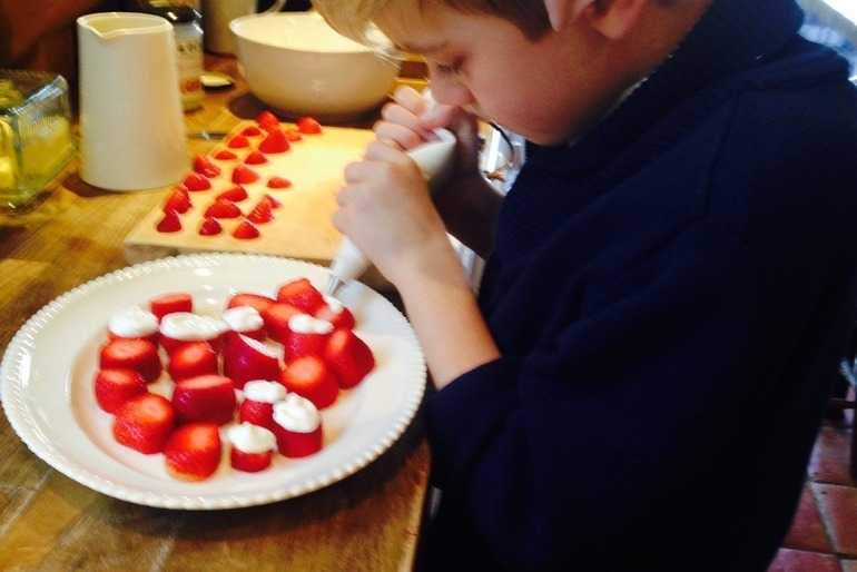 Oliver (with elf ears) making his Homemade Father Christmas Strawberries on Christmas Day image